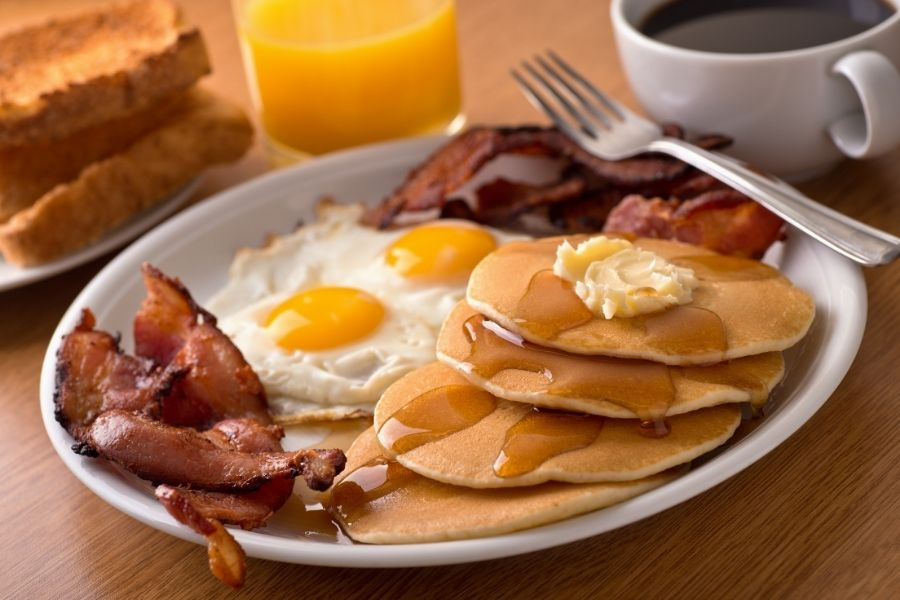 Breakfast with bacon, eggs, pancakes